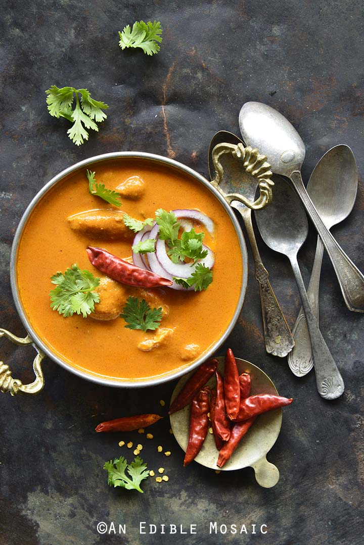 Indian Butter Chicken Recipe (Murgh Makhani) with Vintage Spoons on Antique Metal Tray