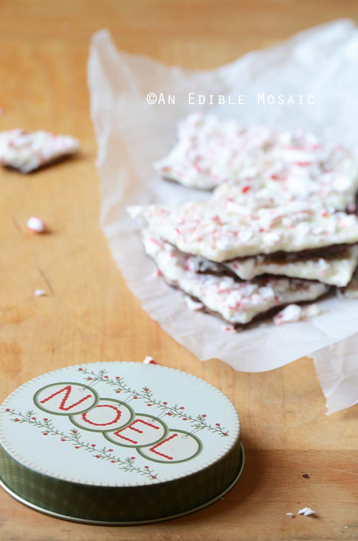 Peppermint Chocolate Bark on White Wax Paper on Wooden Table