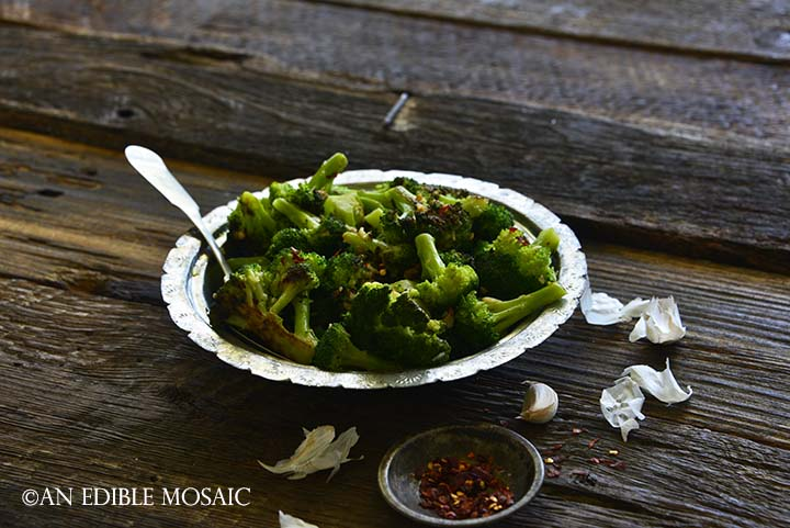Front View of Spicy Italian Broccoli in Bowl with Crushed Red Pepper Flakes