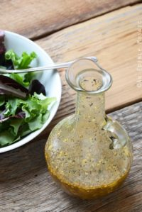 Best Dressing for Salad in Glass Bottle on Wooden Table