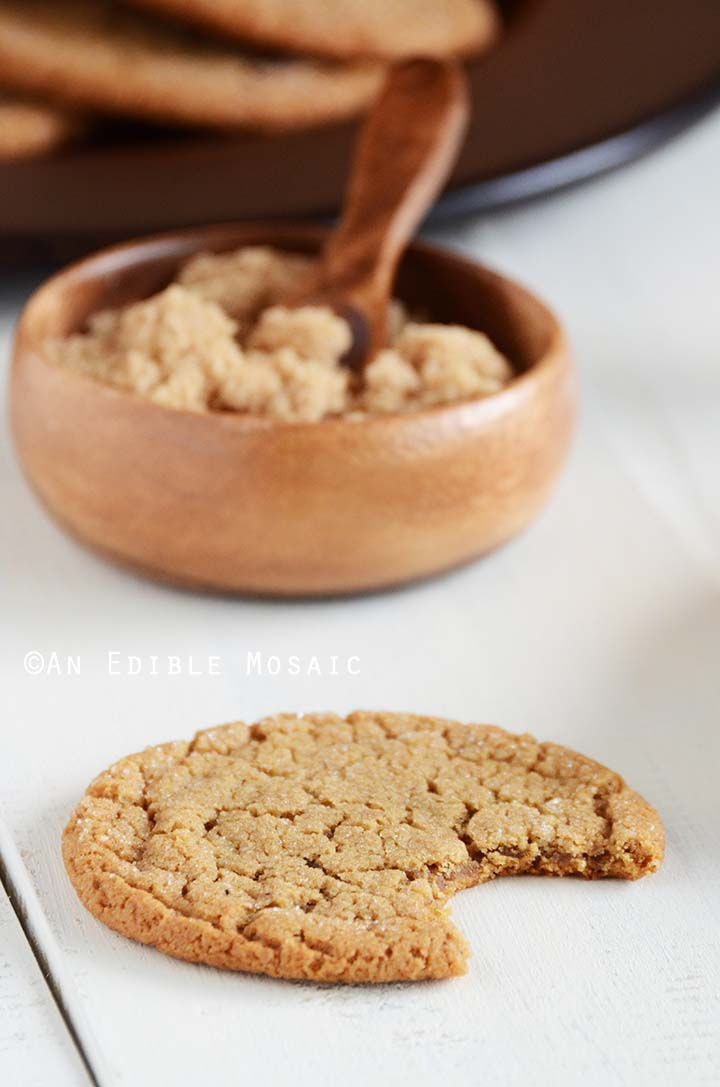 Molasses Cookies on White Wooden Table with Brown Sugar in Background