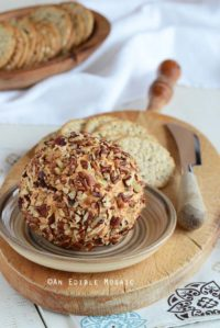 Cheddar Cheese Ball on Wooden Tray with White Linen in Background