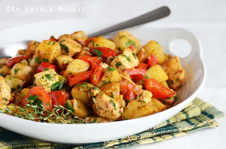 Front View of Turkey Hash in White Dish with Spoon