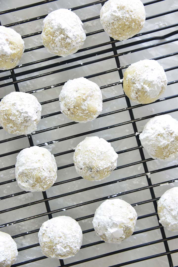 Snowball Cookies Dusted in Powdered Sugar on Wire Rack