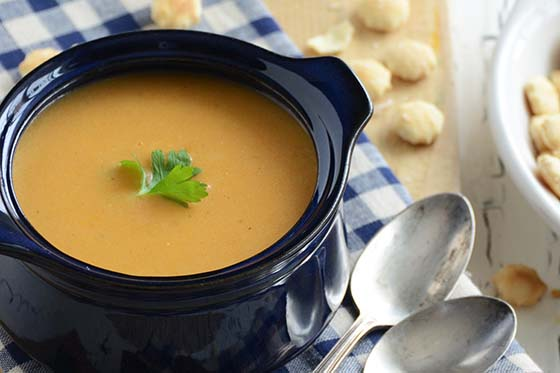 Red Pepper Smoked Gouda Soup in Blue Bowl