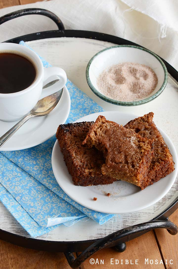 Homemade Cinnamon Bread on White Plate on Blue Fabric on Breakfast Tray