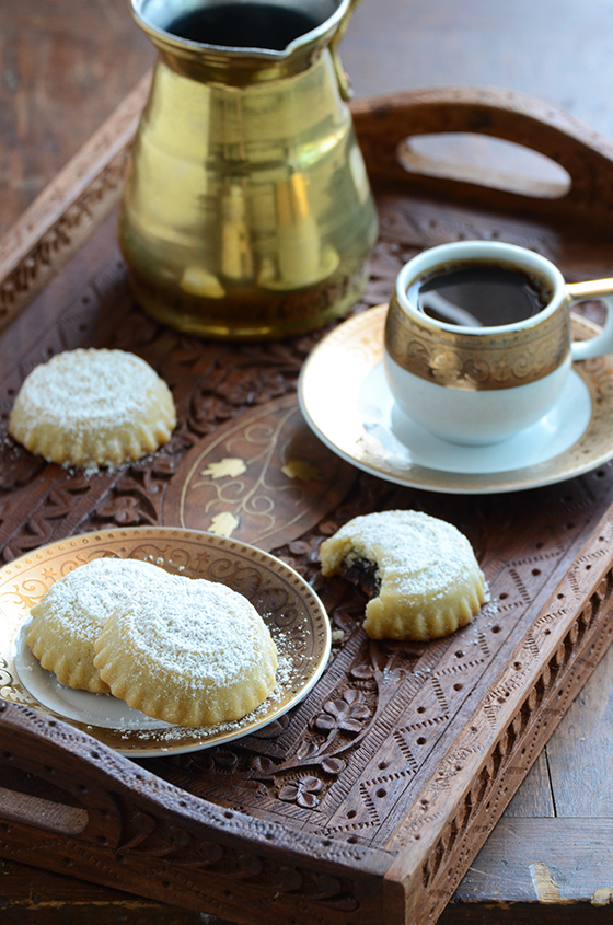 Ma'amoul (Date Filled Cookies) on a Wooden Tray with a Turkey Coffee Pot and Cup of Coffee