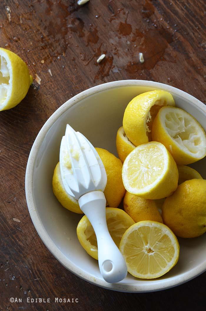 White Bowl of Fresh Lemons on Dark Wooden Table