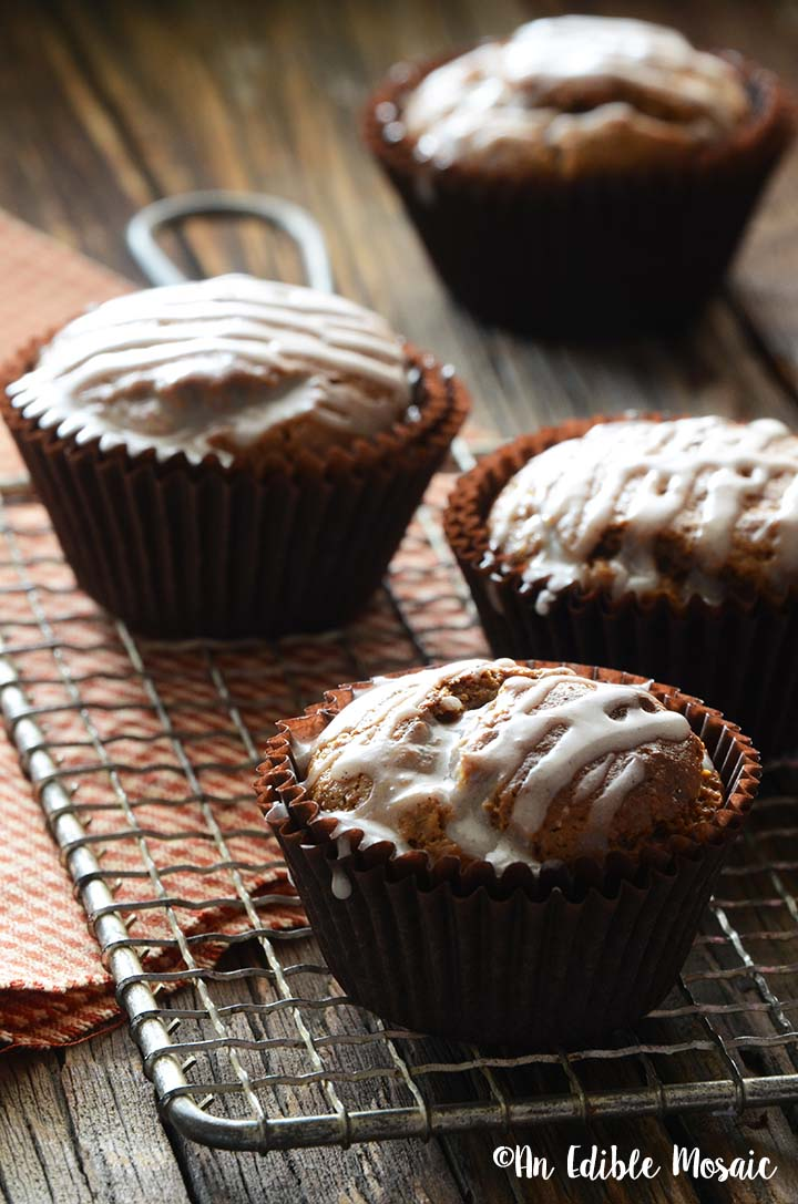 Front View of Gingerbread Muffins on Wooden Table with Red Linen and Wire Rack