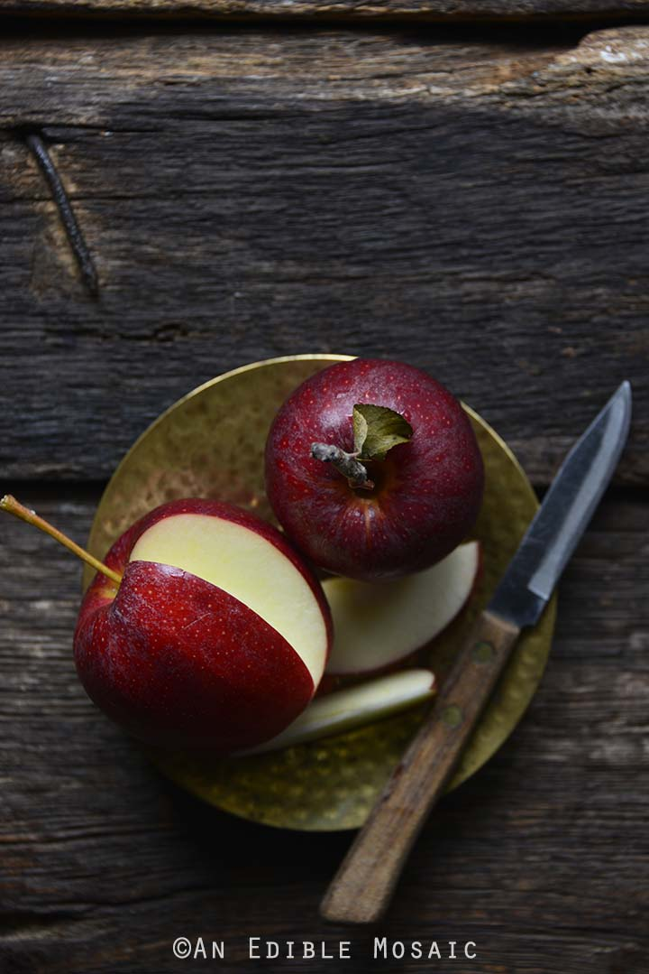 Fresh Apples on Golden Plate on Dark Wooden Table