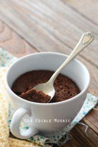 Healthy Chocolate Mug Cake Recipe in White Mug on Wooden Table