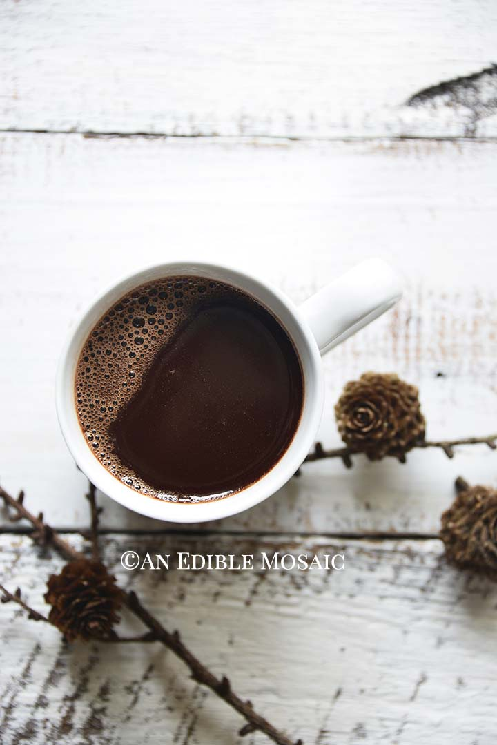 Drinking Chocolate (French Hot Chocolate) with Acorns on White Wooden Farmhouse Table