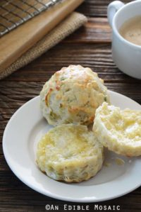 Savory Scones with Scallion and Cheese on Small White Plate on Wooden Table