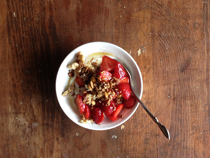 Greek yogurt topped with local organic strawberries, walnuts, honey, and a sprinkling of homemade granola.