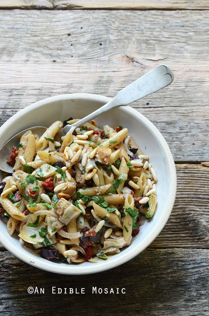 Mediterranean Pasta Salad Recipe in White Bowl on Wooden Table