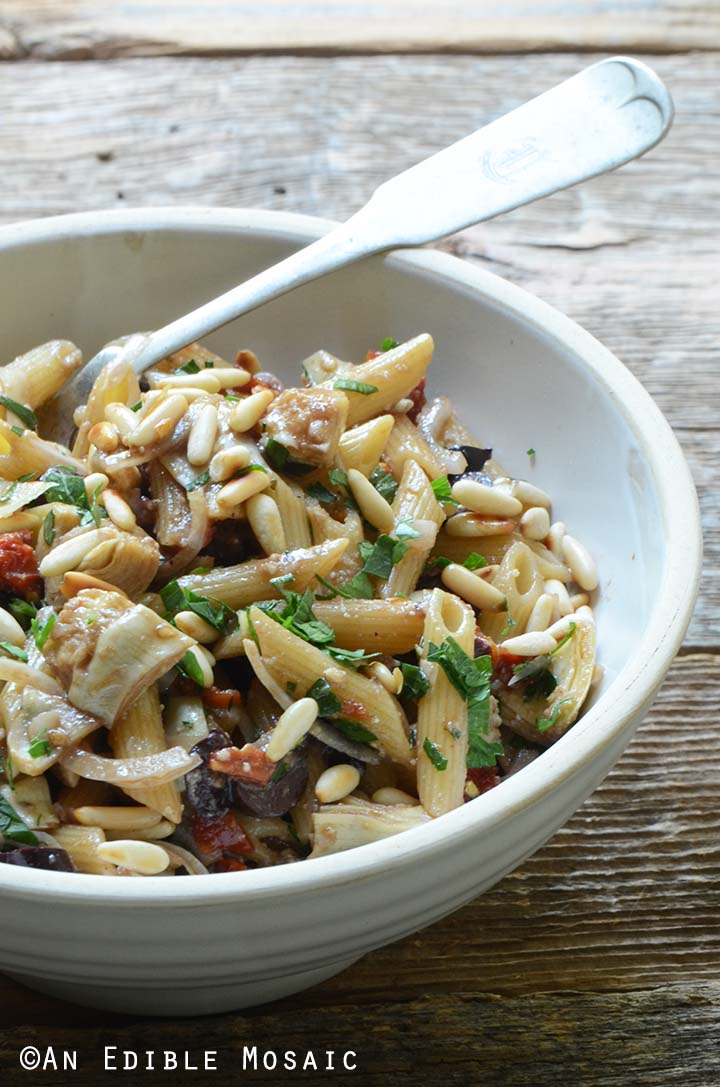 Close Up Front View of Mediterranean Pasta Salad Recipe in White Bowl