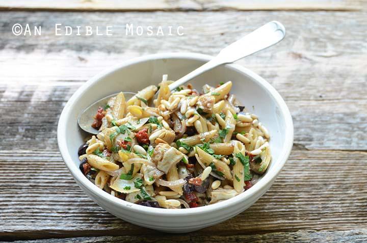 Mediterranean Pasta Salad in White Dish with Spoon