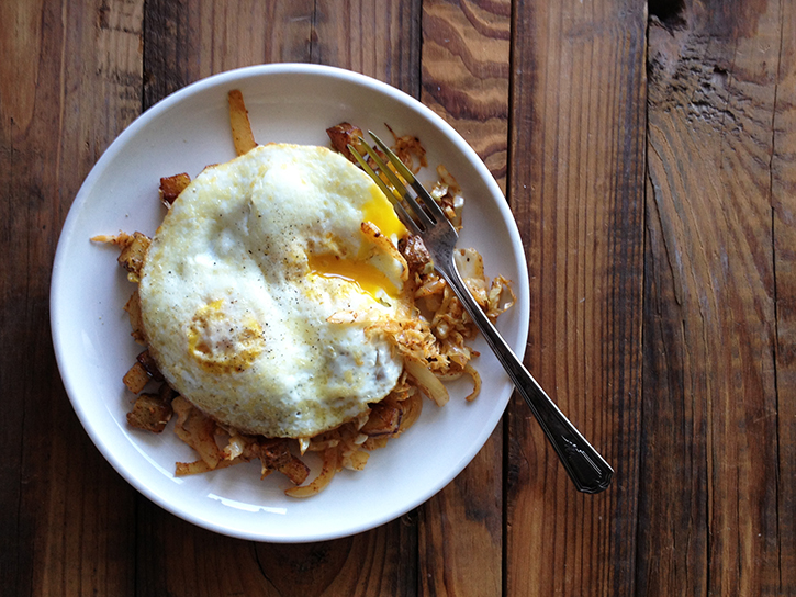 Sautéed cabbage hash topped with fried eggs.