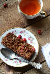Slice of Paleo Cranberry Bread on Small Flowered White Plate with Vintage Spoon