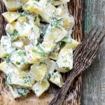 Creamy Dijon Potato Salad on Wooden Plate
