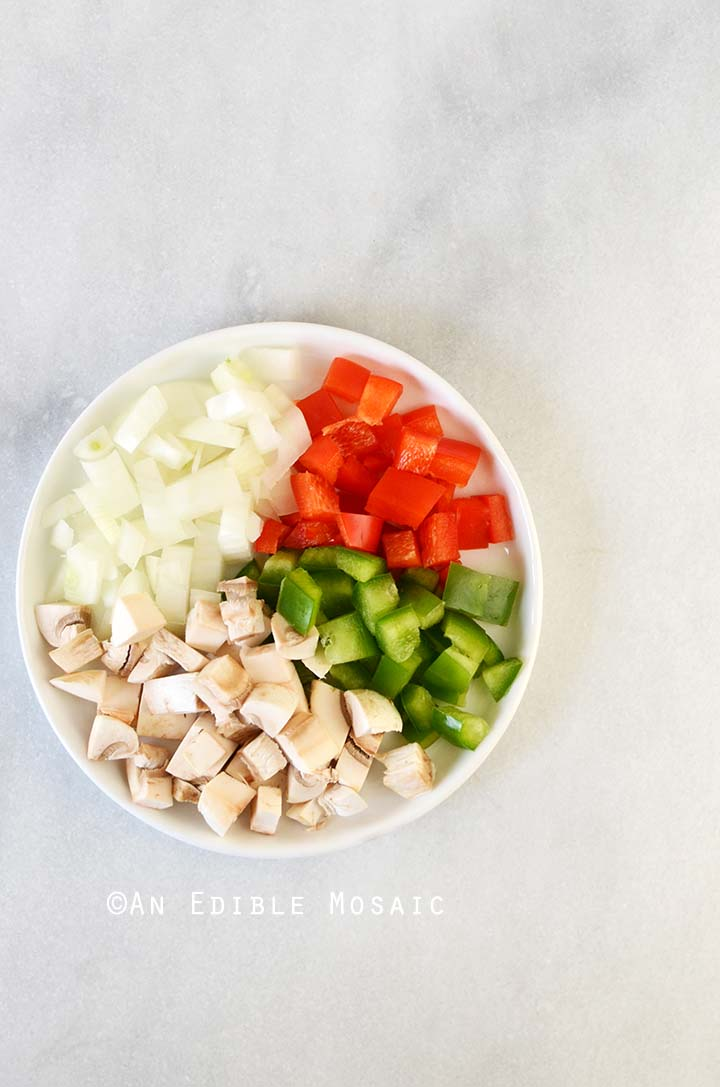 Chopped Vegetables for Western Omelet on White Plate