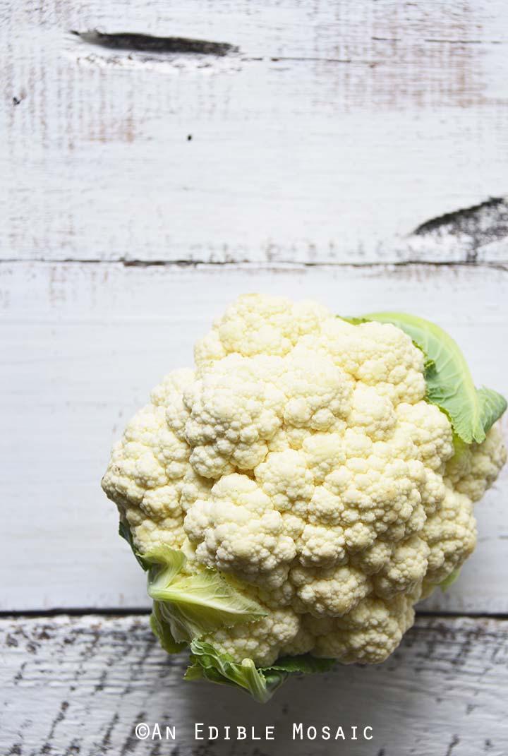 Cauliflower Head on White Wooden Table