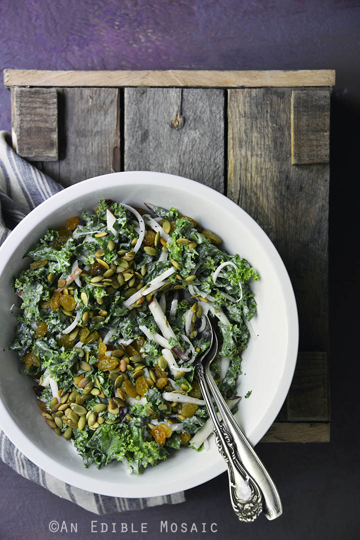 Creamy Poppy Seed Kale Slaw with Red Pear, Toasted Pepitas, and Golden Raisins 1