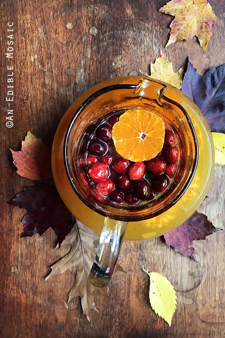 tangerine-lemonade-with-clove-infused-simple-syrup-and-fresh-cranberries-1