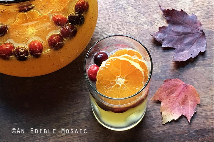 tangerine-lemonade-with-clove-infused-simple-syrup-and-fresh-cranberries-4
