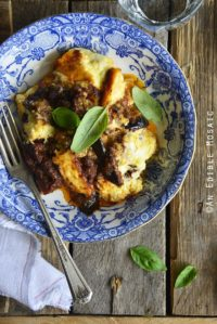 Low Carb Moussaka in Blue and White Flowered Dish on Wooden Table