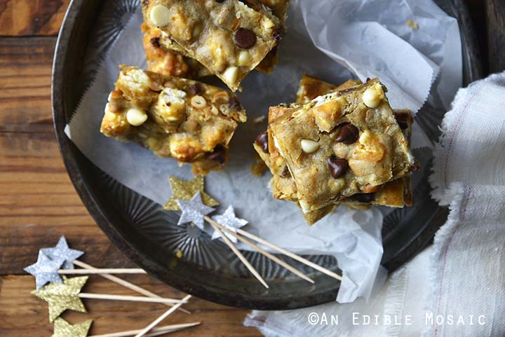 Ballpark Blondies (aka Brown Butter Blondies with Caramel Corn, Salted Peanuts, and White and Dark Chocolate Chips) Top View Metal Pan and Wooden Background with Star Decorations