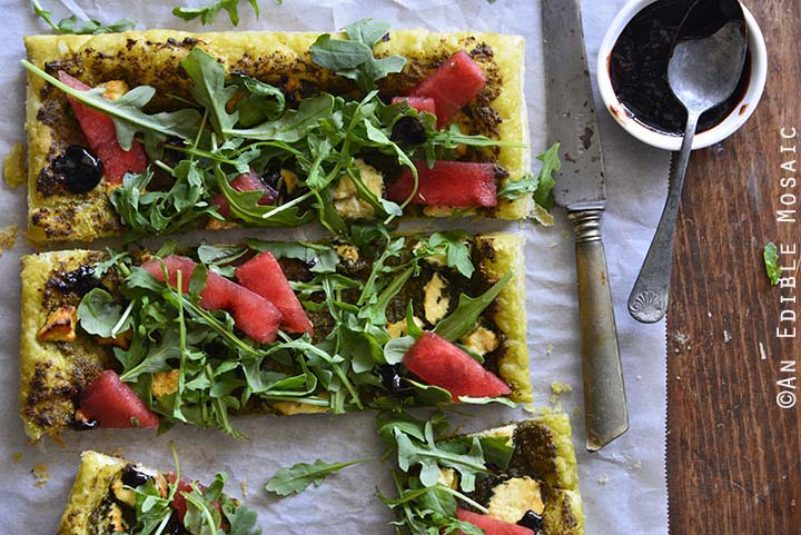 Garlic and Chive Goat Cheese and Pesto Puff Pastry Tart with Arugula, Watermelon, and Strawberry-Balsamic Drizzle Top View, Horizontal Orientation