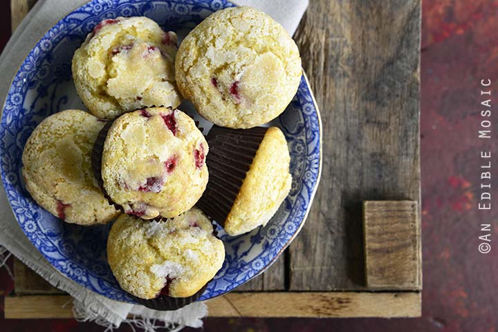 Overhead Horizontal View of Strawberry Lemonade Muffins in a Blue Bowl on a Wooden Background