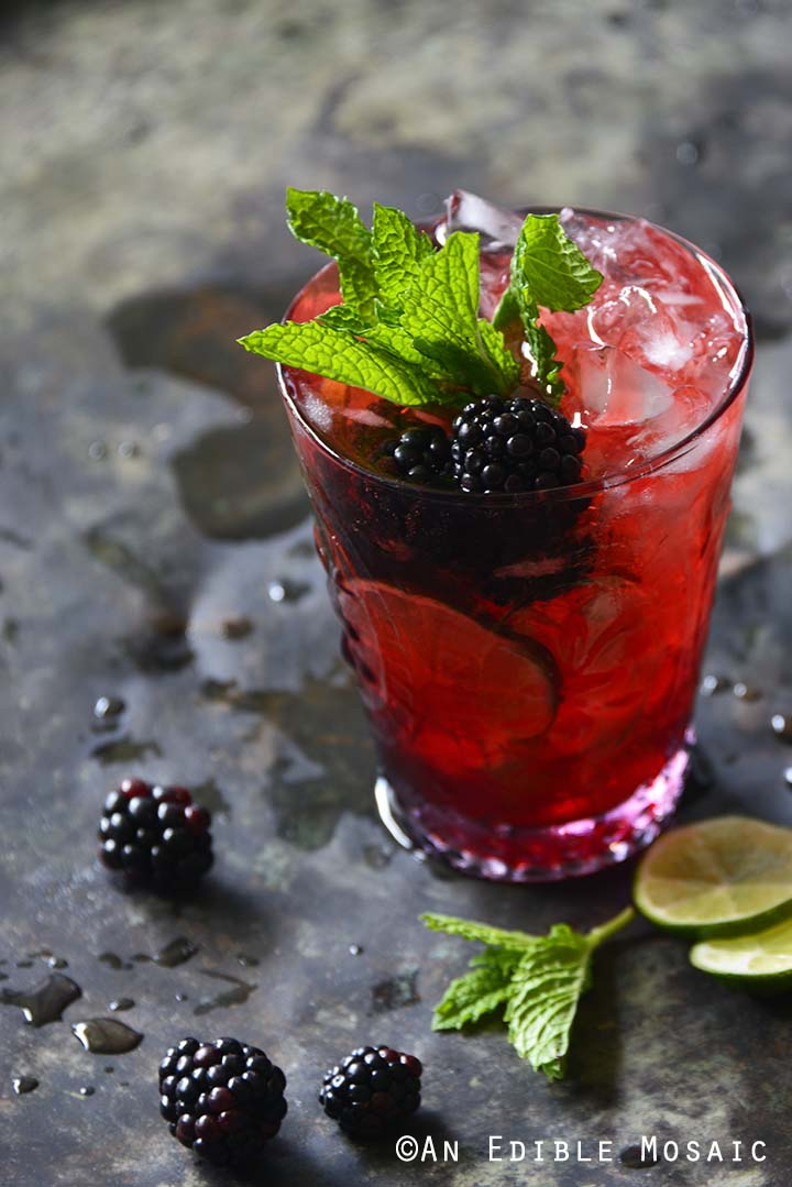 Blackberry Syrup, Mint, and Lime Spritzers on Metal Tray Front View Vertical Orientation