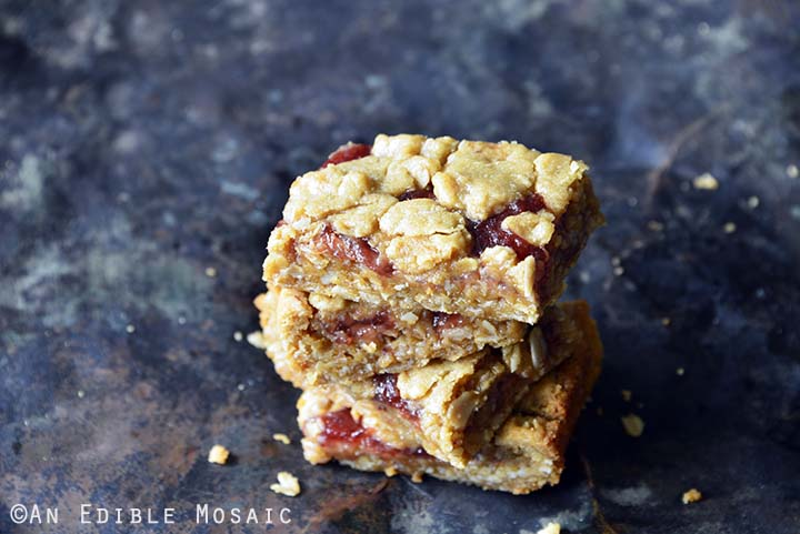 Crumble-Topped Peanut Butter & Co. Peanut Butter Strawberry Jam Bars Front View Showing Layers on Metal Background Horizontal Orientation