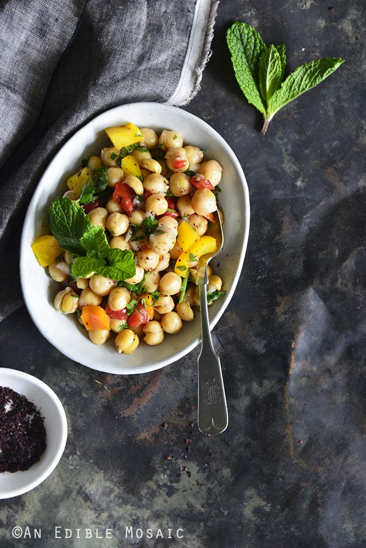 Sweet Pepper Chickpea Salad with Mint and Honey-Sumac Vinaigrette Top View Metal Background One Dish