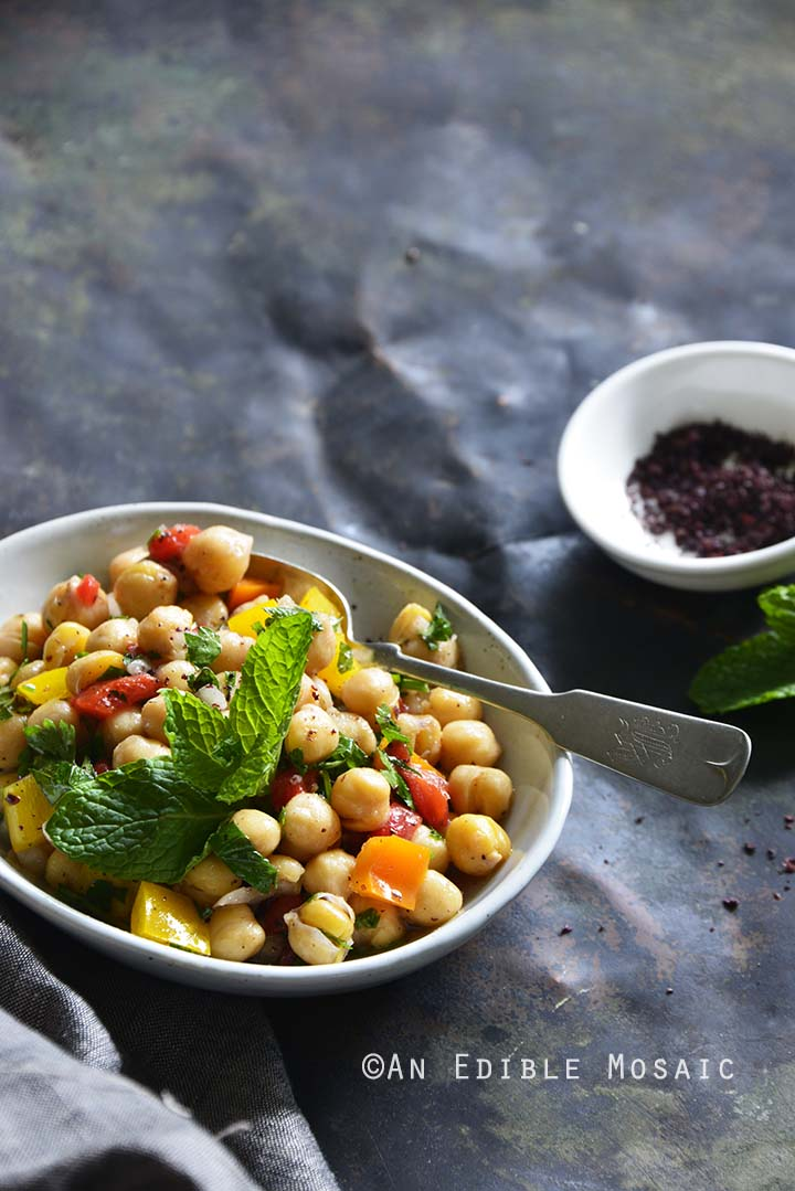 Sweet Pepper Chickpea Salad with Mint and Honey-Sumac Vinaigrette Front View Metal Background Vertical Orientation
