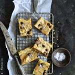 Salted Peanut Butter and Chocolate Snickers Brown Butter Blondies Overhead View on Metal Tray