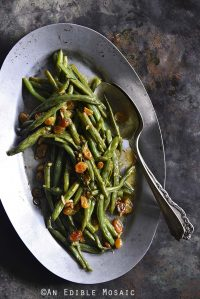Green Beans with Garlic and Golden Raisins Close Up