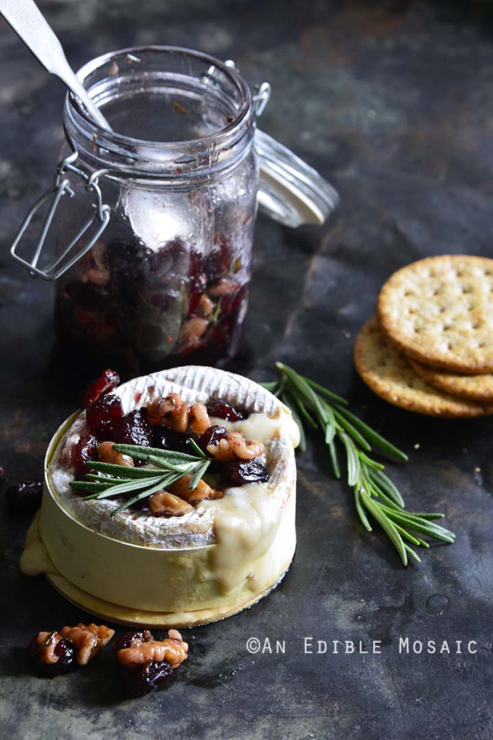 Gooey Baked Goat Brie with Spiced Rosemary-Scented Honey and Red Wine Cranberries Front View