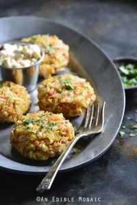 Old Bay Roasted Red Pepper Quinoa Seafood Cakes on Serving Platter with Vintage Fork