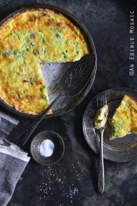 Low-Carb Keto Quiche Lorraine in Tart Dish with a Single Serving on a Plate on the Side