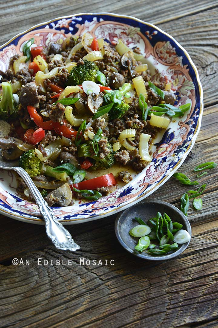 Close Up of 30-Minute Low-Carb Sesame Vegetable Beef Stir Fry with Small Dish of Scallion