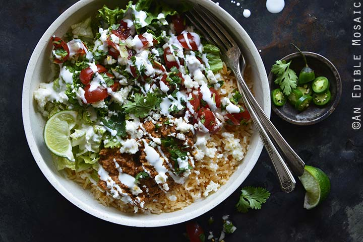Close Up of Chorizo Refried Bean Burrito Salad Bowls with Queso Fresco