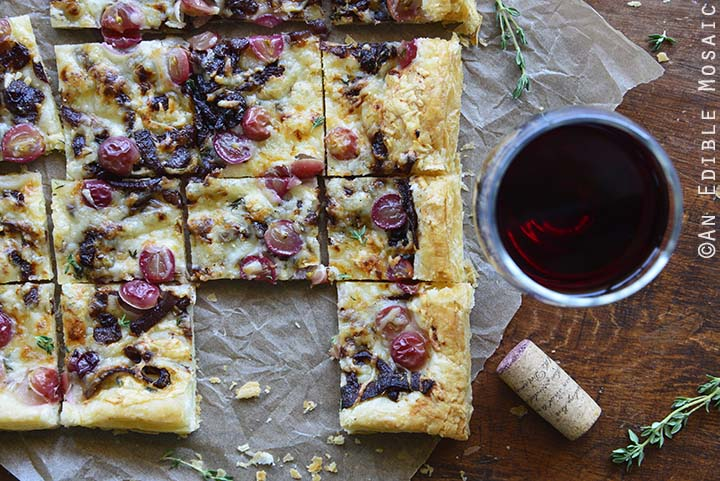Close Up of Easy Manchego, Grape, and Thyme Flatbread with Red Wine Caramelized Onions