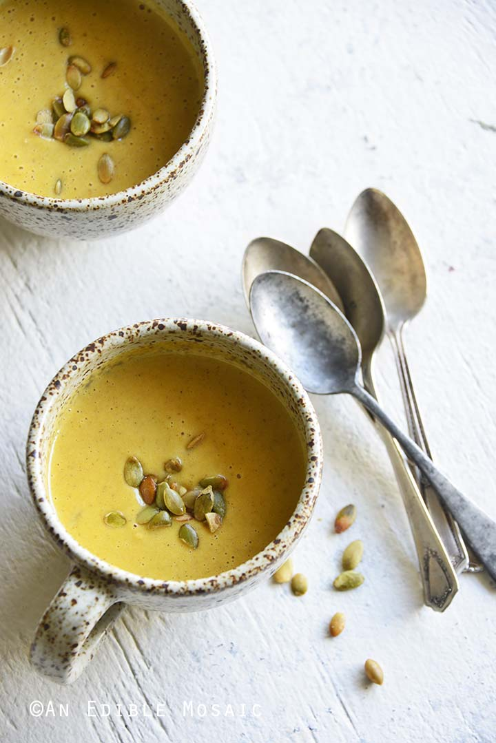 Easy Pumpkin Soup Recipe for One with Pumpkin Spice with Vintage Spoons on White Table