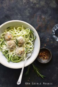 Bowl of Low Carb Cheesy Turkey Meatballs with Rosemary Cream Sauce on Metal Tray