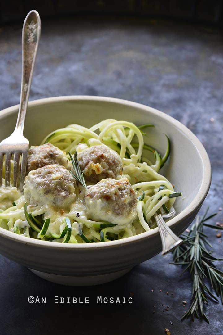 White Bowl of Low Carb Cheesy Turkey Meatballs with Rosemary Cream Sauce with 2 Forks