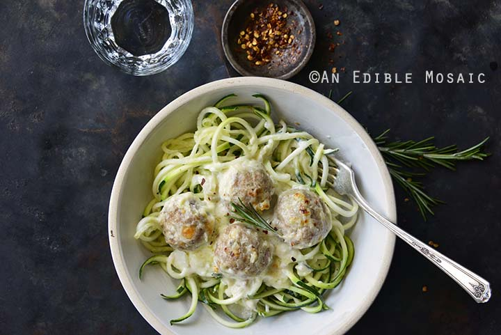 Close Up of Low Carb Cheesy Turkey Meatballs with Rosemary Cream Sauce in White Dish