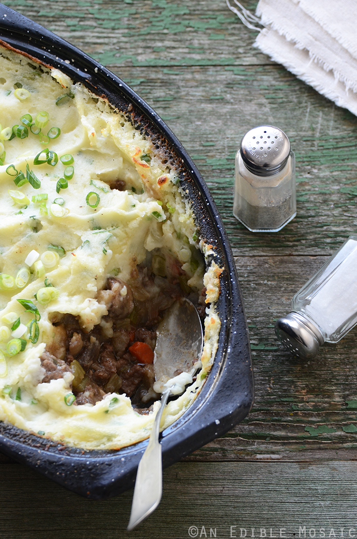 Champ-Topped Vegetable Beef Guinness Casserole on Green Table